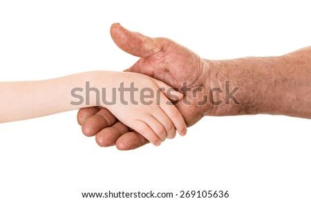 grandfather and child handshake - stock photo