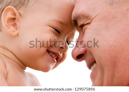 Grandfather and grandchild smiling - stock photo