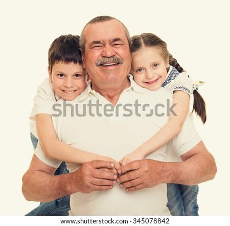 Grandfather and grandchildren portrait - stock photo