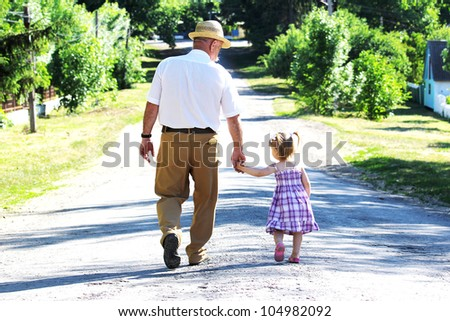 Grandfather and granddaughter - stock photo