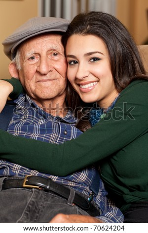 Grandfather and granddaughter lifestyle in a home setting. - stock photo