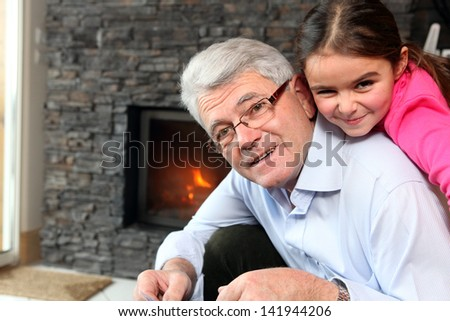 Grandfather and granddaughter playing - stock photo