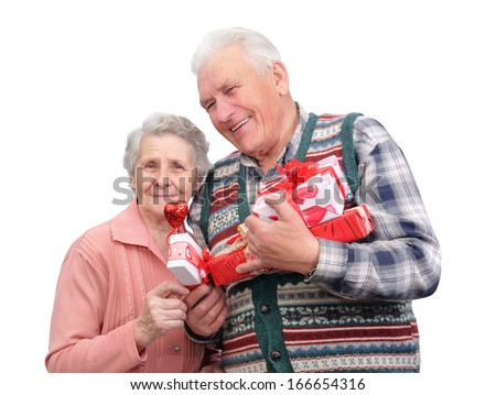 grandfather and grandmother with gifts on white background  - stock photo