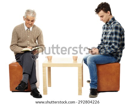 Grandfather and grandson at a cup of tea - stock photo