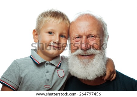 Grandfather and grandson smiling on white background - stock photo