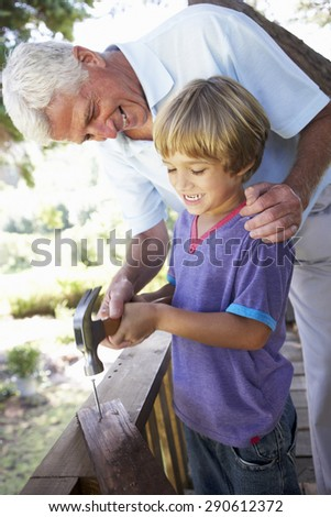 Grandfather And Grandsonon Building Tree House Together - stock photo
