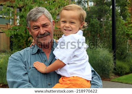 Grandfather and his four year old grandson.  - stock photo