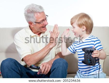 grandfather child game console - stock photo