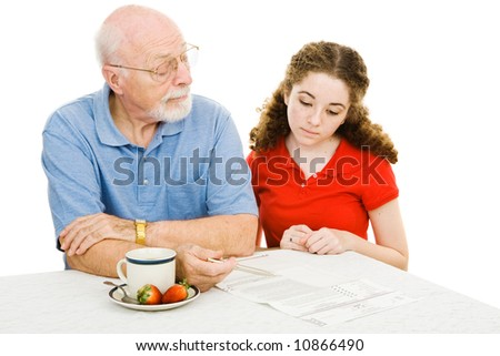 Grandfather explains the democratic process to his teen granddaughter.  Isolated on white. - stock photo