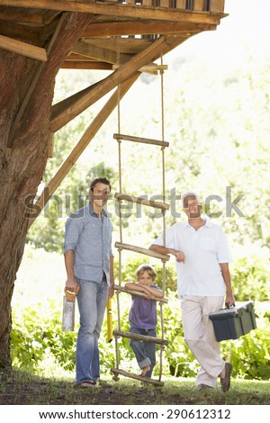 Grandfather, Father And Son Building Tree House Together - stock photo