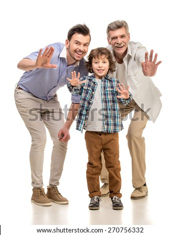 Grandfather, father and son smiling and looking at camera, isolated a white background. - stock photo