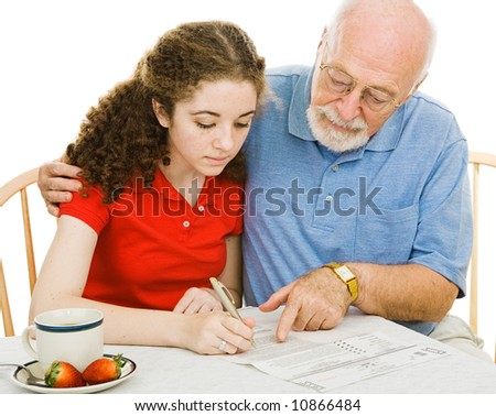 Grandfather helping his daughter vote for the first time with an absentee ballot.  White background. - stock photo
