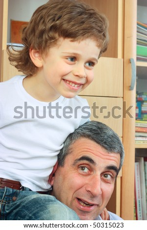 grandfather playing with grandson - stock photo