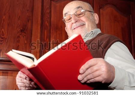 grandfather reading a book - stock photo