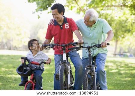 Grandfather son and grandson bike riding - stock photo