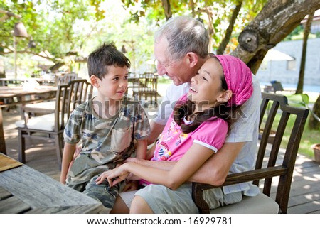 Grandfather spending wonderful time with grandchildren. Concept of love, affection and appreciation. - stock photo