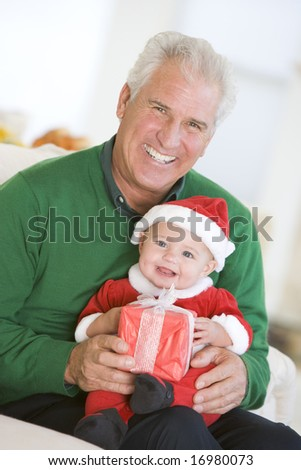 Grandfather With Baby In Santa Outfit - stock photo