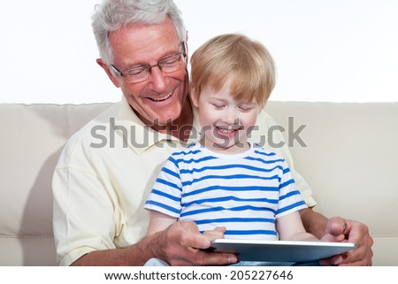 grandfather with child playing - stock photo