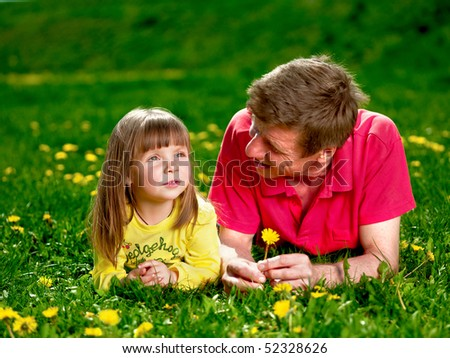 grandfather with granddaughter on meadow - stock photo