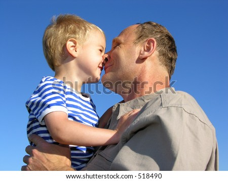 grandfather with grandson kiss by nose - stock photo