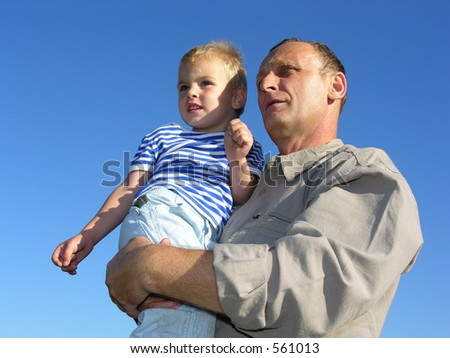 grandfather with grandson look at horizon and future - stock photo