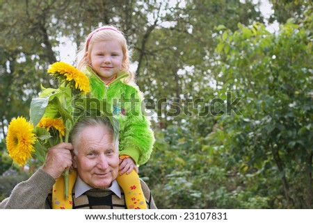 grandfather with little girl outdoor - stock photo