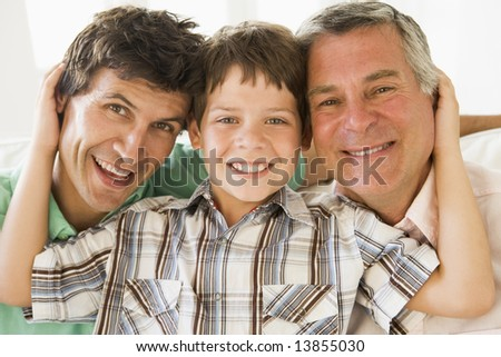 Grandfather with son and grandson smiling - stock photo