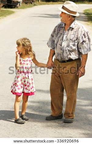 grandfather with the granddaughter go on the road