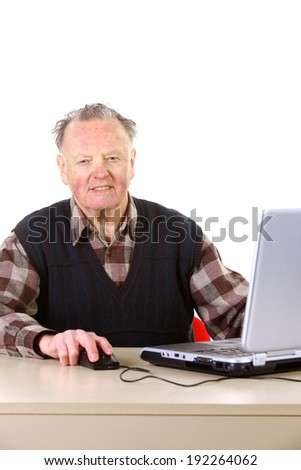 Grandfather working with laptop