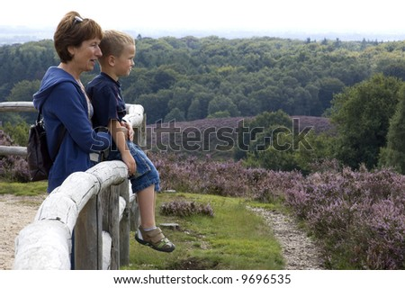 Grandma and grandson looking at a beautiful landscape. - stock photo