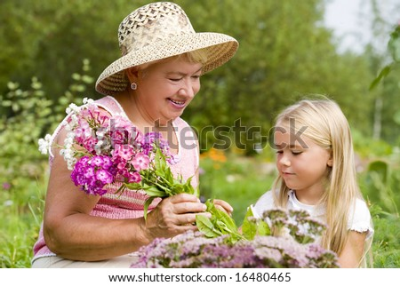 Grandma and her grandchild have a rest in the park - stock photo