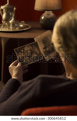 Grandma watching photos of the members of her family
