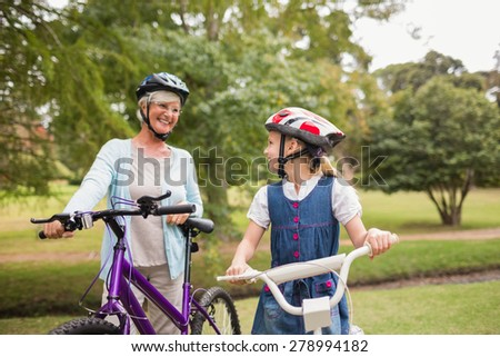 Grandmother and daughter on their bike on a sunny day - stock photo