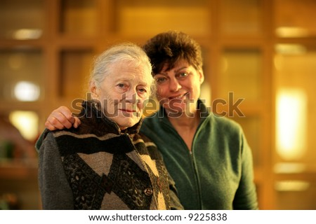 Grandmother and daughter together. Shallow DOF. - stock photo