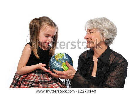 Grandmother and girl holding the earth isolated on a white background