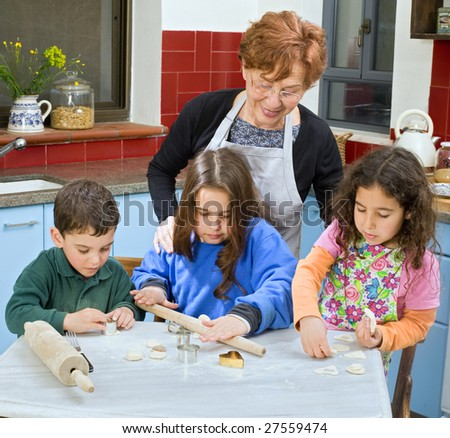 grandmother and grandchild baking cookies together - stock photo