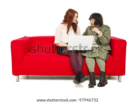 Grandmother and Grandchild in a sofa with computer