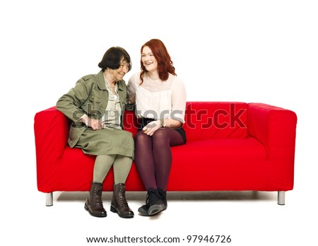 Grandmother and Grandchild sitting in a sofa