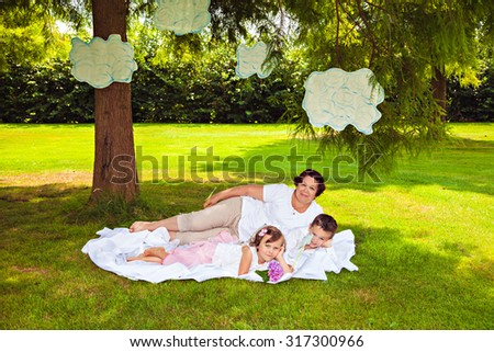 Grandmother and grandchildren playing with clouds in park - stock photo