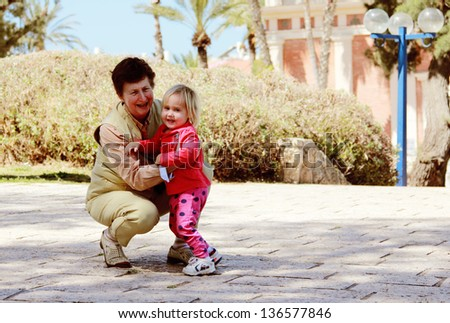 Grandmother and granddaughter - stock photo