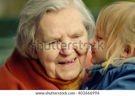 Grandmother and granddaughter. Happy family. MANY OTHER PHOTOS FROM THIS SERIES IN MY PORTFOLIO. - stock photo