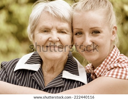 Grandmother and granddaughter. Happy family. Vintage style. - stock photo