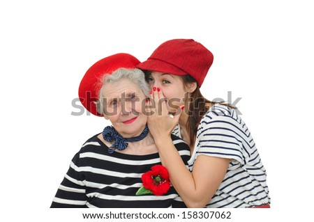 grandmother and her granddaughter whispering on white background - stock photo