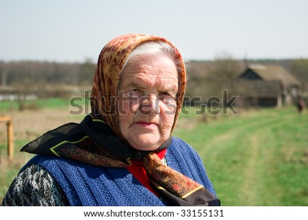 Grandmother at her motherland - stock photo