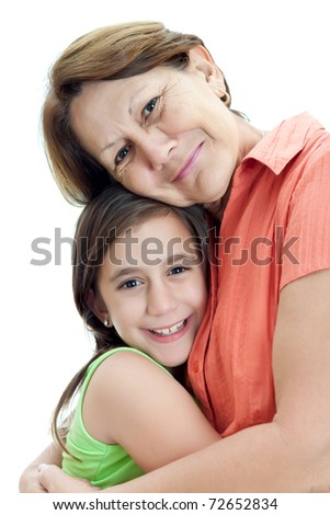 Grandmother hugging her little granddaughter isolated on a white background - stock photo