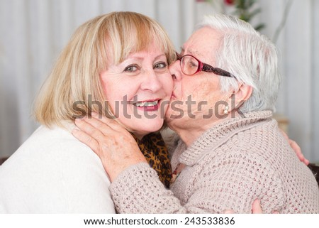 grandmother kisses her daughter
