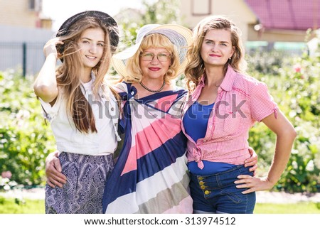 Grandmother ,mother and daughter  in the summer park - stock photo