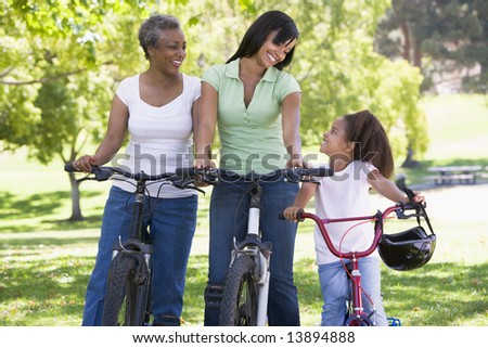 Grandmother mother and granddaughter bike riding - stock photo