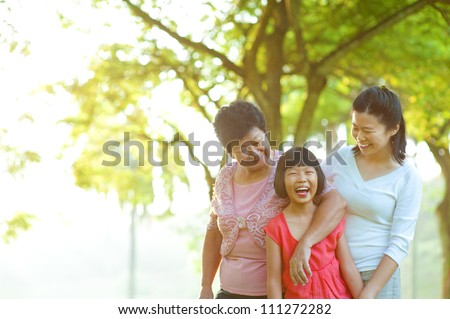 Grandmother, mother and me at outdoor park - stock photo