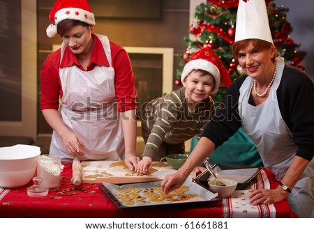 Grandmother, mum and son making christmas cake together at home, smiling.? - stock photo